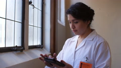 Hispanic female doctor with tablet Arkistovideo