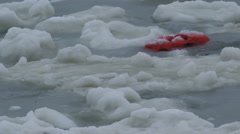 Lost Life Jacket in Frigid Arctic Storm Waves and Sea Ice close 4K - stock footage