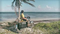 Motorcycle parked on beach shore Stock Footage