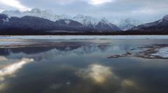 Low Flight over Chilkat River toward Mountains Winter Alaska Stock Footage
