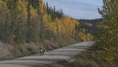 Motorcyclist on Cassiar Highway Canada in Autumn 4K Stock Footage