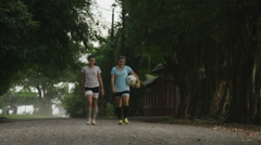 Wide panning shot of soccer players walking on dirt road / Esterillos, - stock footage