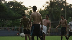 Wide slow motion panning shot of soccer teams playing on field / Esterillos, - stock footage