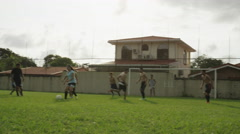 Wide panning shot of soccer teams playing on field / Esterillos, Puntarenas, - stock footage