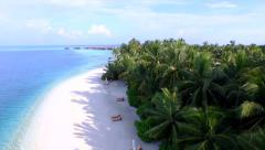 AERIAL: Luxury island resort on exotic white sand beach - stock footage