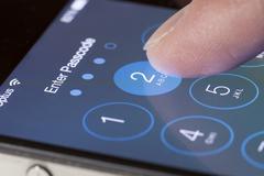 Enter passcode screen of an iPhone Stock Photos