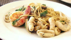 Eating fresh and hot seafood spaghetti on the table Stock Footage