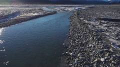 Passing Upstream over Gravel Flowing Riverbed Alaska Aerial Stock Footage