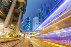 Traffic in the financial district of Hong Kong at night - stock photo