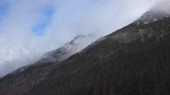 Ponderous Clouds Enshroud Steep Alaskan Mountainside TL 4K Stock Footage