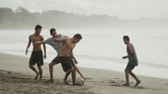 Wide panning shot of people playing soccer on beach / Esterillos, Puntarenas, Stock Footage