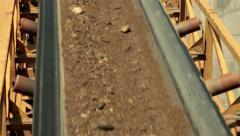 Sand, stones and soil going up on conveyor belt. Separating sand for asphalt. Stock Footage