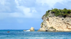 Zoom Shot of Fishing Boat and Cliff Stock Footage