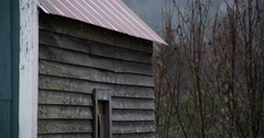 Rain Dripping off Metal Roof Rustic Cabin Misty Foggy Day with Folia Stock Footage