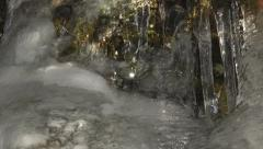 Rise Up Past Glowing Ice Bulge to Icicle Moss Cave in Dappled Sun 4K Stock Footage