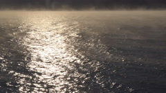 River Fog in Winter on Windy Day over Waves 4K Stock Footage