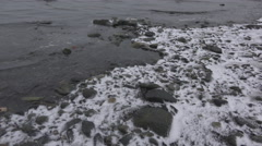 Rocky Incoming Tide over Light Snow 4K Stock Footage