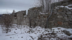 Ruined Foundation Walls of Stone and Plumbing Snowy Pan Right Stock Footage