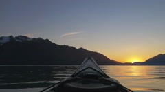 Sea Kayak POV Sunset Southeast Alaska with Mountains Stock Footage