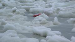 Search and Rescue Life Preserver Adrift in Heaving Sea Ice 4K Stock Footage
