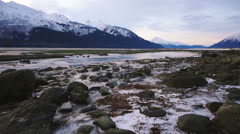 Skimming Low over Icy Rocks and Scenic Winter Beach Chilkat Haines A Stock Footage