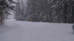 Small SUV Passes by In Snowy Forest Winter Road Stock Footage