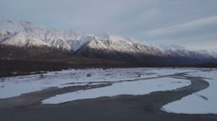 Snowy Klehini River and Takshanuk Mountains Lateral Diagonal Descent Stock Footage