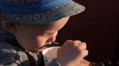 Little boy eats a strawberry milkshake Stock Footage