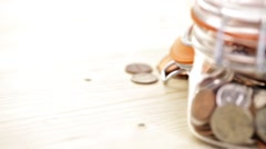 Saving money into glass jar for future investment. Stock Footage