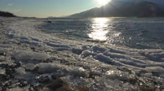 Sunny Windy Chilkat Beach with Wind Driven Ice and Waves Slide right 4K Stock Footage