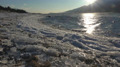 Sunny Windy Chilkat Beach with Wind Driven Ice and Waves Slide left 4K Stock Footage