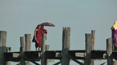 Monks walking on U-Bein bridge,Mandalay,Burma Stock Footage