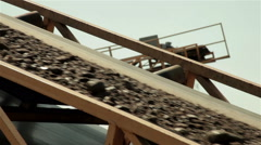 Sand and stones going on conveyor belt Separation sand in construction industry. Stock Footage