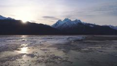 Winter Freezeup Lateral Flight Sundown over Mountains Chilkat River Stock Footage