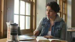 Hispanic female studying, writing notes - stock footage
