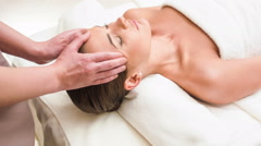 Close up of a young woman receiving head massage - stock footage