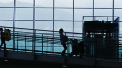 Silhouettes of Travellers in Airport. Stock Footage