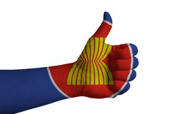 Flag of AEC country with thumbs up hand - stock photo