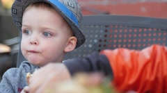 A family eats fast food for dinner outside diner Stock Footage