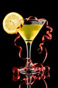 Lemon martini with red streamer - stock photo