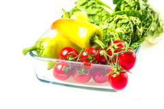 Bunch of vegetables in the glass jar Stock Photos