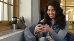 Young female adult texting Stock Footage
