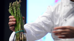 Hands of chef in show cooking Stock Footage