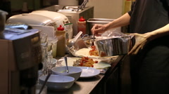 Preparing Mexican food, making burritos in the kitchen of Mexican restaurant-Dan Stock Footage