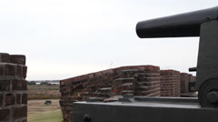 Cannon on fortress wall with target below Stock Footage