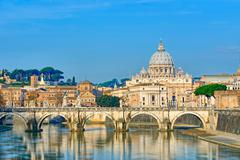 Bridge of Castel St. Angelo on the Tiber.Dome of St. Peter basilica, Rome - I - stock photo