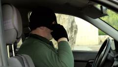 Robber sitting in car Stock Footage
