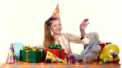 The birthday treats all his gifts, very good mood. white background Stock Footage