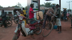 People filling jerry cans at gas station, Nigeria Stock Footage