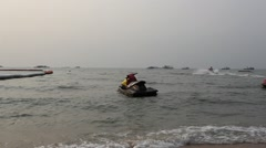 Jet Ski on the waves at Pattaya beach Stock Footage